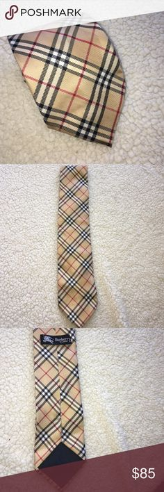 Classic Burberry London men's tie Gorgeous and 100% authentic classic Burberry London men's neck tie. Perfect condition worn one time by my husband Burberry Accessories Ties