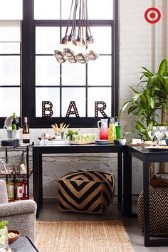 It's easy to turn two Parsons desk into a party when company comes calling. Create a mini bar and food buffet by setting them up in a corner. Up the celebratory vibe with marquee letters, and have poufs on hand for extra seating or serving options.