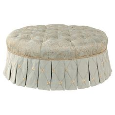 Add stately appeal to your living room or home library with this button-tufted cocktail ottoman, showcasing a paisley print and pleated skirt.
