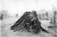 How horrible the earthquake and fire was. Men at makeshift refugee shelter after the San Francisco earthquake. Bear Photo Company, 1906.