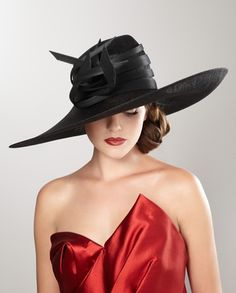 Philip Treacy hats run hot and cold with me.  Some are so far over the top and some, like this, are divine.