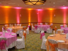 Orange-and-Pink-Wedding-Decorations. I like this but the tables need a big enough centerpiece