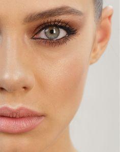Copper smokey eye and matte peach lips.