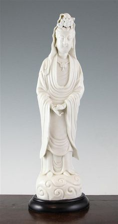 A Chinese blanc de chine standing figure of Guanyin