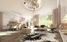 Wystrój wnętrz eleganckiego salonu połączonego z jadalnią. Luksusowe, przestronne wnętrze utrzymane jest w jasnych barwach, ożywionych lustrami na suficie.