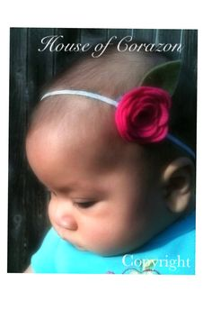 Felt rose offered on a clippie or elastic by HouseofCorazon, $4.50