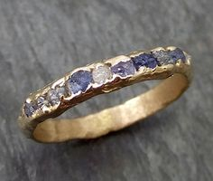 This is a made to order ring and will look similar to images provided in listing. Raw diamonds and Sapphires mens or womens Wedding Band Custom One Of a Kind Blue Montana Gemstone Ring Multi stone Ring byAngeline C0269 Raw rough Montana blue sapphires and raw diamonds in 14k. I hand carved this ring in wax and cast it in recycled solid 14k gold using the lost wax casting process. This one of a kind raw gemstone ring shown here is a size 9 1/2 it can be created in any size needed and whi...