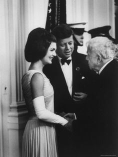 President John F. Kennedy and First Lady Jacqueline Kennedy with poet Robert Frost at the White House.