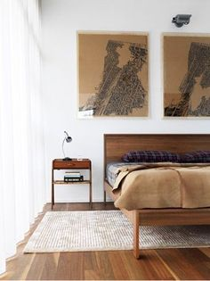 Wood and white bedroom decorated with mid-century furnishings in a modern minimalist style.