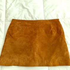 Suede mini skirt Brown genuine suede mini skirt. New without tags. Forever 21 Skirts Mini