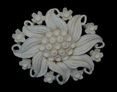 "1950's bubbleite/featherlite flower pin hard white molded plastic cream in color and often referred to as wedding cake design. Measures 2"" x 1 1/2"" $29.00. Free shipping in the US. Questions? PM me via FB. PayPal Only."