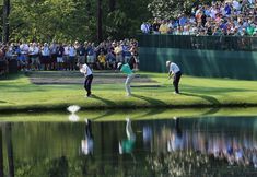 (L-R) Sean O'Hair, Tiger Woods and Mark O'Meara skip their balls over the water during a practice round prior to the start of the 2012 Masters Tournament at Augusta National Golf Club on April 4, 2012 in Augusta, Georgia.