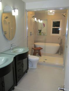 Bath tub inside the shower so you can rinse off after your bath or wash hair.  Master Bathroom Remodel - http://emodelyourhome.wordpress.com