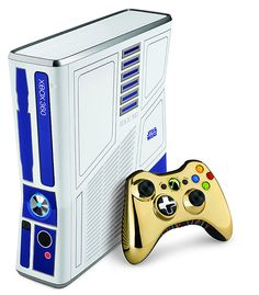 Star Wars Xbox 360 - Dereks birthday present, that I practically stole from GameStop because we traded almost 400 dollars worth of other stuff! It's freaking adorable, the console makes r2d2 noise when you turn it on, and the controller has the 'exposed wires' from c3p0. It almost makes me want to play Xbox!