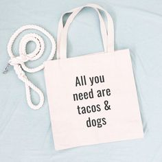 All You Need Are Tacos and Dogs Tote Bag. These simply designed canvas tote bags will be the shopping bag you reach for time and time again. They are roomy enough to hold all your essentials but not so large that you feel like you're lugging a suitcase around. Made from lightweight cotton canvas, they are not only durable but both classic and trendy. 10% of your purchase is donated to help dogs in need at local animal shelters. All You Need Is, How Are You Feeling, Dog Tote Bag, Dog Mom Gifts, Crazy Dog, Dog Photos, Canvas Tote Bags, Animal Shelters, Cotton Canvas
