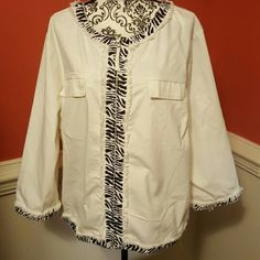 NWT White and black jacket by AMI size 2X NWT White and black jacket by Ami size 2X.. brand new. Never been worn. Zips up and has two front pockets. The back of the sleeves zip up as shown in Pic 3. AMI Jackets & Coats