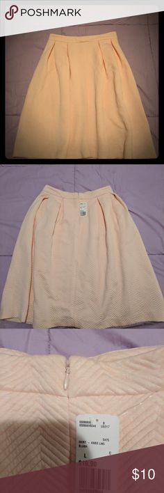 Pleated Peach skirt from Forever 21 Brand new with tags. Pleated peach skirt with zipper on side Forever 21 Skirts Midi