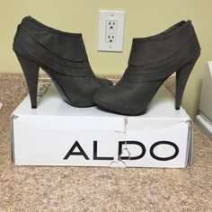 Aldo Booties High Heel Material: Fabric Sole: Synthetic These bootie pumps are a must-have style for the Fall/Winter season. Cuffed and pleated textile upper with concealed platform and chic high heel. - Heel Height: 4.5 inches - Platform Height: 1 inches - Shaft Height: 7 inches- box is a little creased and bent but included in this listing! ALDO Shoes Ankle Boots & Booties