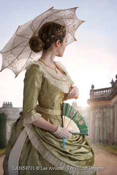 Trevillion Images - victorian-woman-with-umbrella-by-country-house