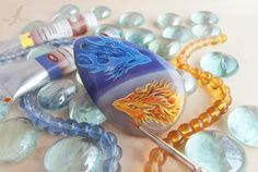 Artist Alvia Alcedo paints intricately detailed dragons on highly polished agate stones for her custom necklaces.
