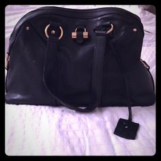 Authentic YSL Muse handbag YSL- Muse handbag. Black with aged gold hard wear. Beautiful bag... top zipper. Really good condition and handbag holds up very well. Couple minor scratches that add character to the handbag. But overall great condition! Handbag comes with certificate cards ;) Yves Saint Laurent Bags Shoulder Bags