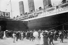 LUSITANIA - arriving in New York City; close-up of starboard side at dock; People await passengers