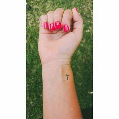 Cross tattoo on Kerry's wrist.