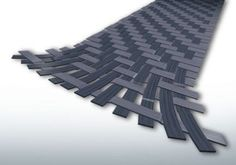 Carbon Fiber or Carbon Fibre (spelling depends on country) refers to long thin strands of material about 0.005 - 0.010mm in diameter, which are composed mostly of carbon atoms. It has the highest compressive strength of all reinforcing materials along with a high strength-to-weight ratio and low coefficient of thermal expansion. These properties allow manufacturers to make parts that are high in strength, heat resistant and lightweight.