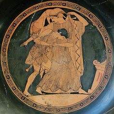 Peleus abducts Thetis, who is shape-shifting into a lioness to fight back, medallion of a cup of Phase IV, border with double meander. By Douris, Athenian red-figurevase-painter and potter active 500 - 460 BCE