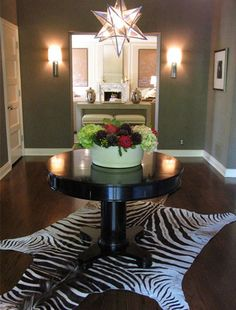 Foyer: zebra rug and round, occasional table