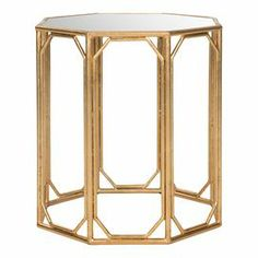 """Open ironwork accent table in gold with an octagonal glass top.   Product: Accent tableConstruction Material: Iron and mirrored glassColor: Gold and silverDimensions: 22"""" H x 19.5"""" W x 19.5"""" D"""
