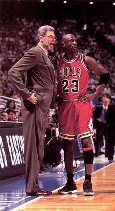Michael Jordan and the coach of the Chicago Bulls, Phil Jackson. The two teamed together in the for six NBA championships. Michael Jordan Basketball, Air Jordan Xi, Love And Basketball, Basketball Legends, Sports Basketball, Basketball Players, College Basketball, Basketball Tickets, Basketball Socks