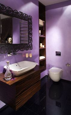 Bathroom Appear Attractive and Convenient With White and Purple Color