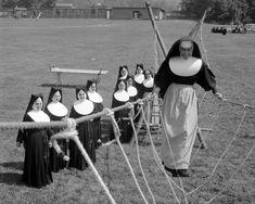 "Nuns having fun will restore your faith in joy. 1963  A walk across ""monkey bridge."""
