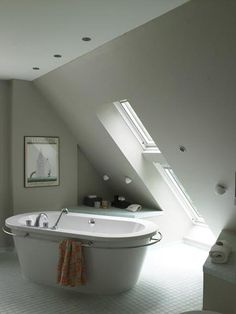 I think I could live with this spa tub in my bathroom. Love the coziness of the space.