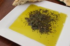 Try this Version Of Carrabbas Bread Dipping Sauce. It's delish and make sure you use the T.I.P. at the top.