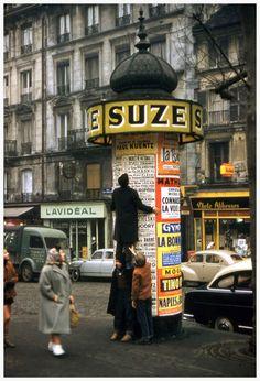Robert Doisneau, The ascent of the column Morris, Paris, 1957.