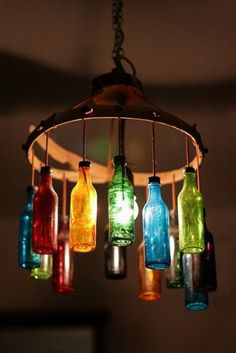Reuse old soda bottles to make this creative and colorful chandelier!