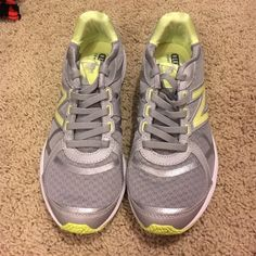 New Balance tennis shoes! Grey and light yellow/green running shoes. Slip on. Elastic laces. No ties. Comfort heel pillow insert. Size 6.5! Worn only once. Brand new condition. New Balance Shoes Athletic Shoes