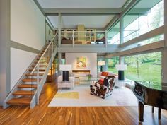 Glass staircase design brightens up home interiors, adding a beautiful architectural feature to modern homes and creating a striking focal point for interior design Modern Staircase, Staircase Design, Loft Style Homes, Bungalow Extensions, Glass Stairs, Flat Roof, Prefab, House In The Woods, My Living Room