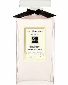 Jo Malone Red Roses Bath Oil, 200ml Like bathing in fresh rose petals, the intense scent of this bath oil with its seven types of roses, blooms in the water and leaves the sensuality of honeycomb, clove and musk lingering on the skin. http://www.comparestoreprices.co.uk/health-and-beauty/jo-malone-red-roses-bath-oil-200ml.asp