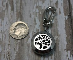 Essential Oil Diffuser Keychain- Aromatherapy Keychain- Stainless Steel Diffuser Keychain- Diffuser Keychain- Floral Tree Keychain  Have your favorite essential oils with you diffusing on your keychain any time! Still experience the benefits of your oils even on the go. A gorgeous whispy floral tree to fit any style. All of the pieces used to create this necklace are made with surgical grade stainless steel to ensure that the oils do not break down the metal and tarnish your jewelry. The…