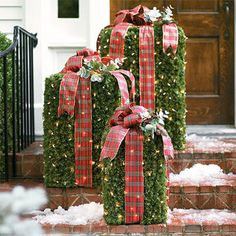 Diy outdoor presents- you can use anything for the shape( plastic container, upside down trash can,whatever can take weather) and wrap in garland, or maybe even a cheap vinyl shower curtain? Then decorate it up!