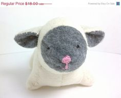 Etsy.com: A cream lamb with grey/gray face and ears. Hand-sewn with love just for you! Facial features are also sewn on.    Measures approximately 6 Lamb stuffed animal small $16.20