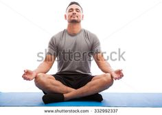Young Man Sporty Outfit Doing Yoga Stock Photo (Edit Now) 332992337 Mat Exercises, Sporty Outfits, Model Release, How To Do Yoga, Young Man, Photo Editing, Meditation, Royalty Free Stock Photos, Mens Tops