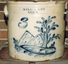3 Gal. crock with a landscape and tree and possible lake in the foreground. Very rare.
