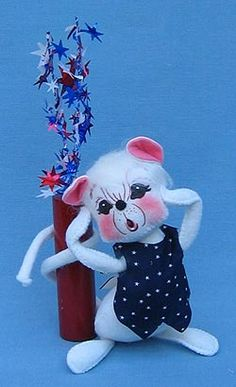 """Annalee 7"""" Firecracker Mouse  Annalee Doll Description: Open eyes, ooh mouth """"surprised"""" - as shown, white hair and body, blue vest with white stars, firecracker wrapped around tail with """"sparklers"""" at the end. It is very common for the red from the firecracker to rub onto the tail where it is wrapped around. Adorable! www.suecoffee.com"""