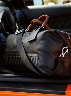 Reminiscent of the interior of a vintage luxury automobile, this duffel bag is crafted