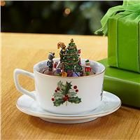 """Teacup Christmas Music Box. A musical holiday tea party! Animated 5 12"""" x 4 12"""" H teacup has a mouse family parading around the tree to Jingle Bells. Bottom wind-up key.. Price: $29.99"""