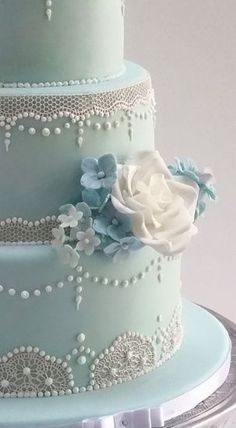 This cake was for a beautiful wedding in a barn in Gloucester. I love the delicate feel that comes from the lace overlaying the pale blue sugarpaste. Extravagant Wedding Cakes, Cool Wedding Cakes, Wedding Desserts, Blue Wedding Cupcakes, Buttercream Wedding Cake, Sweet 15 Cakes, 15th Birthday Cakes, Old Fashioned Wedding, Quinceanera Cakes
